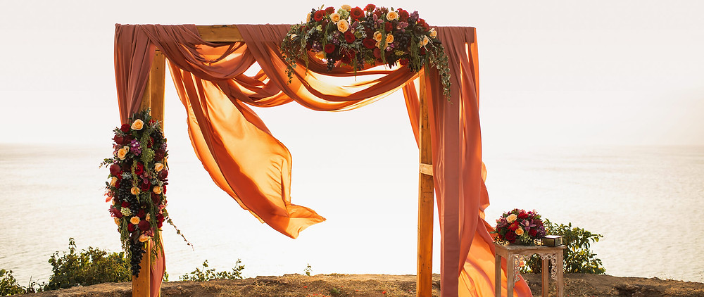 Fall fabric and flowers for a wedding altar