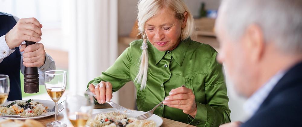 A lady enjoying her retirement dinner