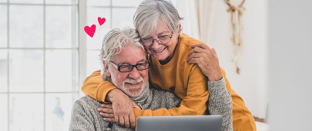 A couple watching their vidday video anniversary gift