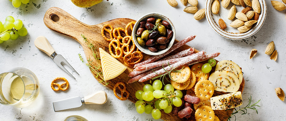 a charcuterie board filled with different foods for an anniversary