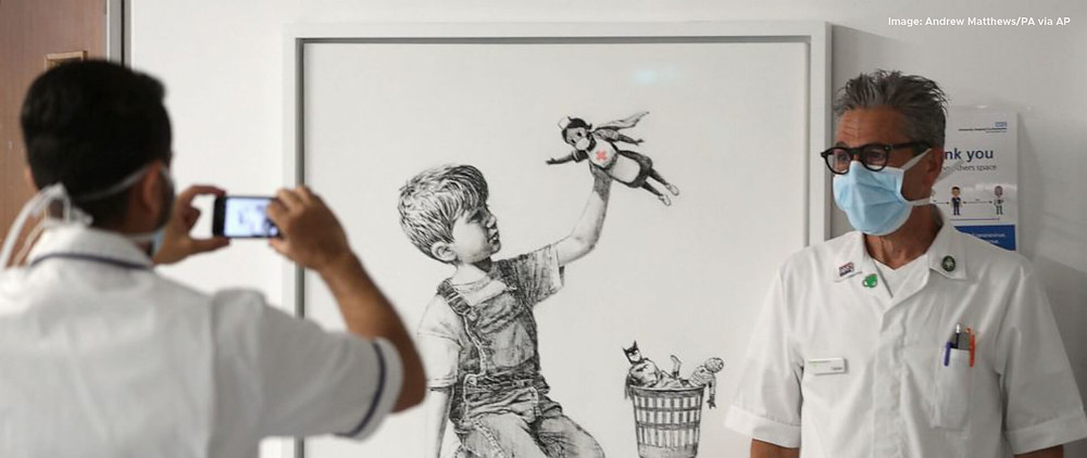 Banksy painting sells for record price to fund NHS.