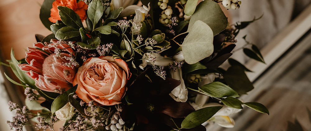 A wedding bouquet in fall colors