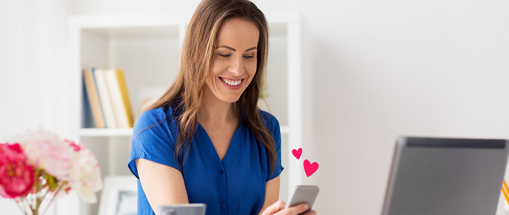 a woman watching her VidDay for an employees work anniversary