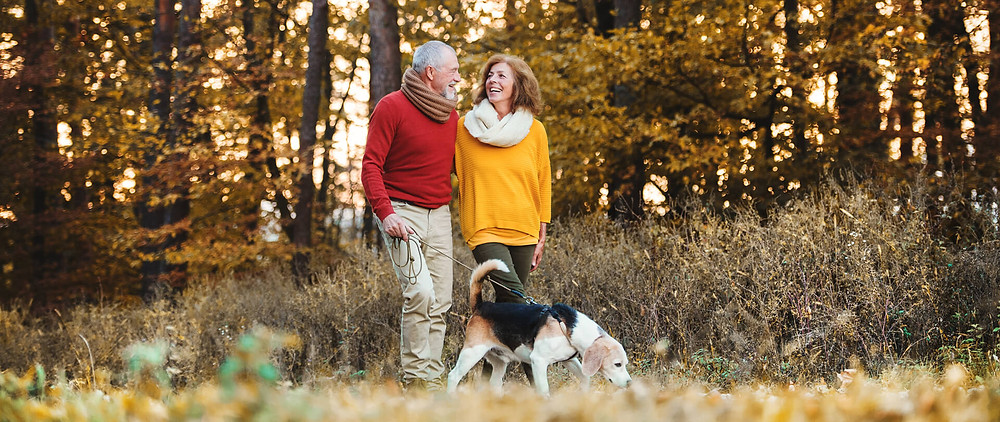 A couple taking a hike for a fall anniversary idea
