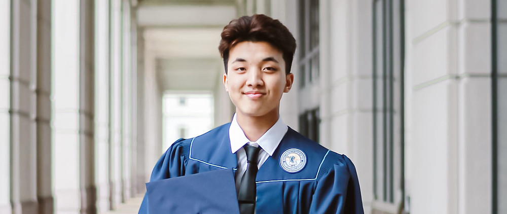 A graduate with their cap and robe for graduation day