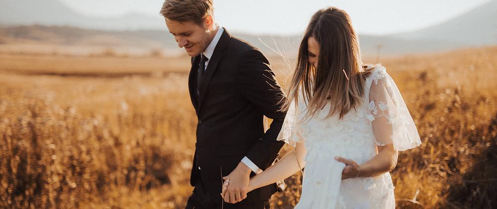 A fall wedding photos take in grass