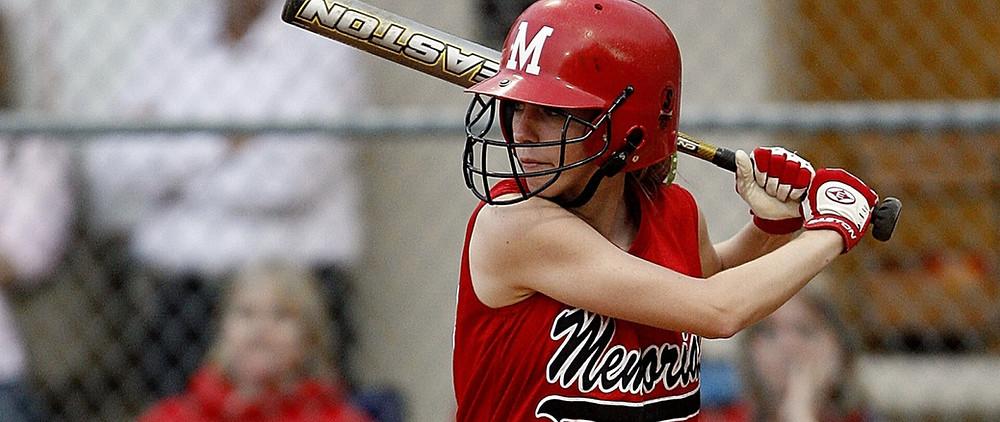 A lady playing baseball