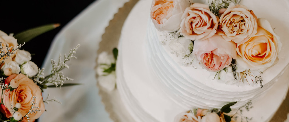 A wedding cake with flowers on top