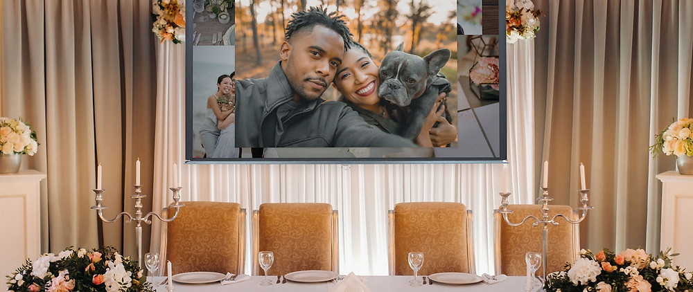 A VidDay wedding video gift being shown at a wedding