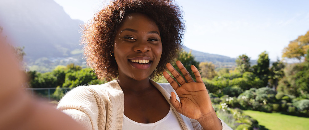 A woman recording a selfie video message