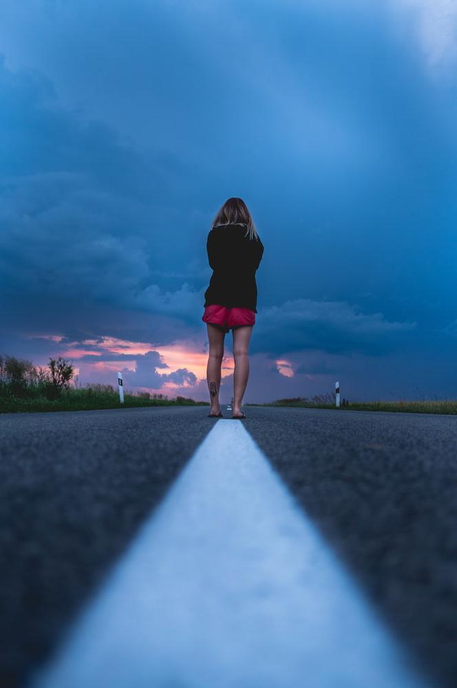 women exercising on road