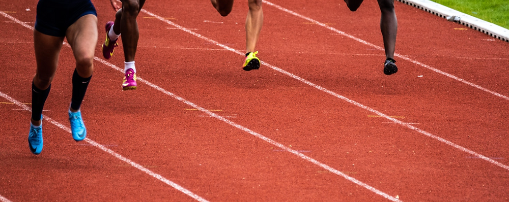 Athletes racing on a track - sports performance