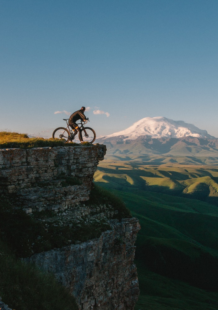 man cycling on a mountain with good nutrition