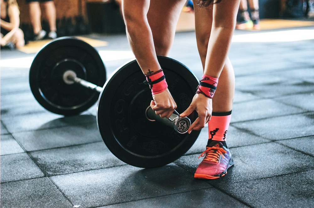 Women with weights for strength training.