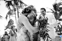 wedding bride hugs emotional photographer moments
