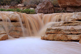 The waterfalls around the Grand Canyon are stunning but everyone in the family will probably need to be excellent shape in order to hike to it.