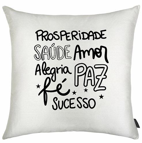 Almofada Branca Quadrada com as palavras: Prosperidade, Saúde, Amor, Alegria, Paz, Fé e Sucesso em letras decorativas pretas