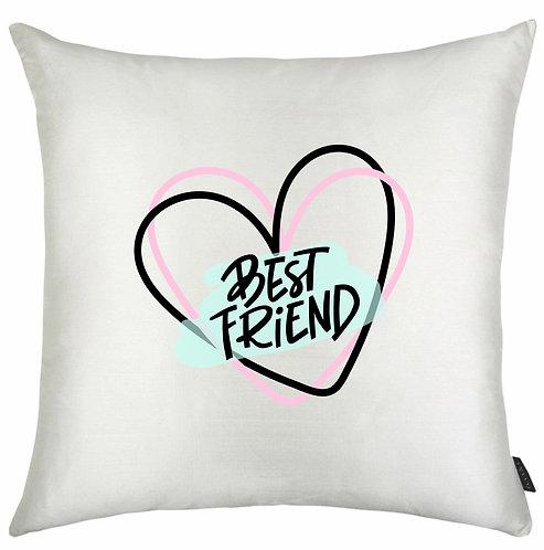 Almofada quadrada branca com o desenho de um coração com o texto Best Friend no centro