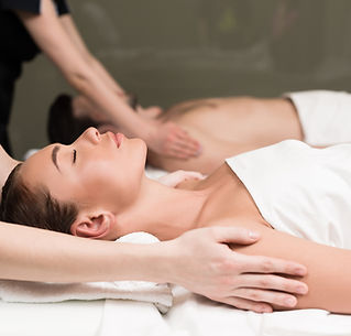 side-view-of-couple-having-massage-in-sp