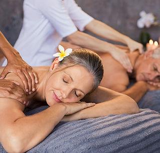mature-couple-having-massage-at-spa-J29H