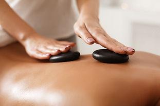 masseur-doing-back-hot-stone-massage-clo