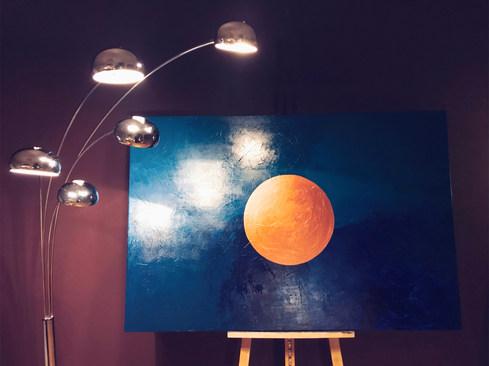 Kupfer-Kreis auf blautürkisem Hintergrund