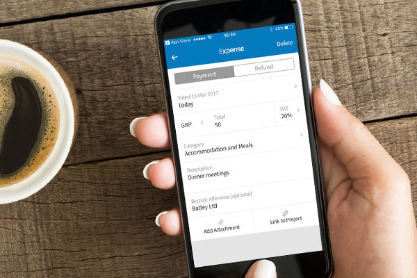 A person doing their expenses on the FreeAgent Mobile app
