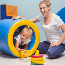 Child exercising with young therapist du