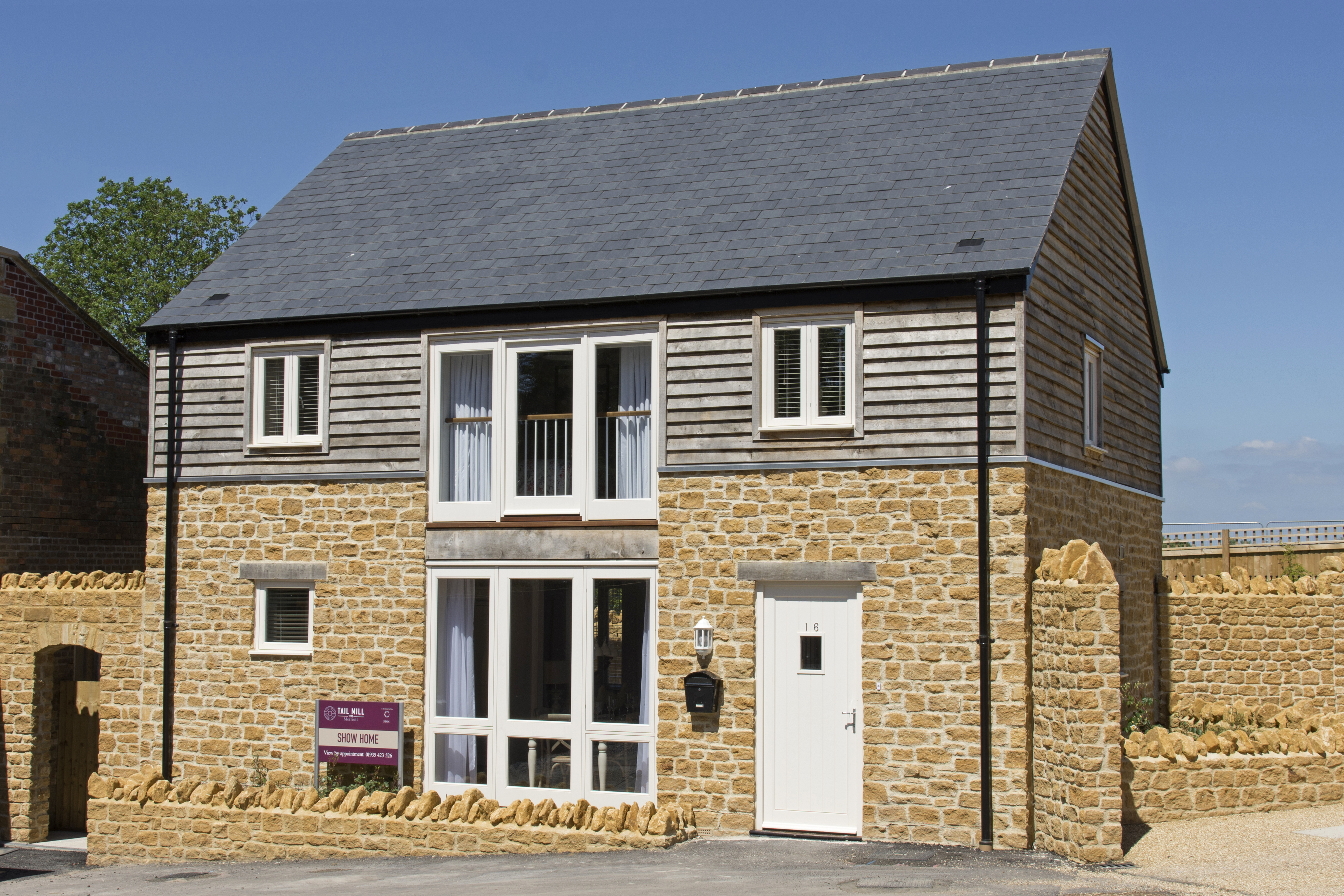 Tail Mill new-build housing, Merriott, Somerset - house with Ham stone and timber cladding
