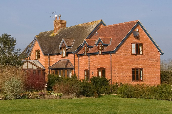 Red brick extension to a lodge in Marston Magna, Somerset