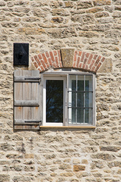 Tail Mill listed building conservation, Merriott, Somerset - The Warehouse window with shutters