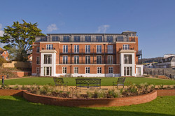 Classical brick apartment building with terraces in Sidmouth, Devon