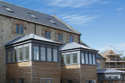 Tail Mill conservation, Merriott, Somerset - warehouse extensions with timber cladding and zinc roof