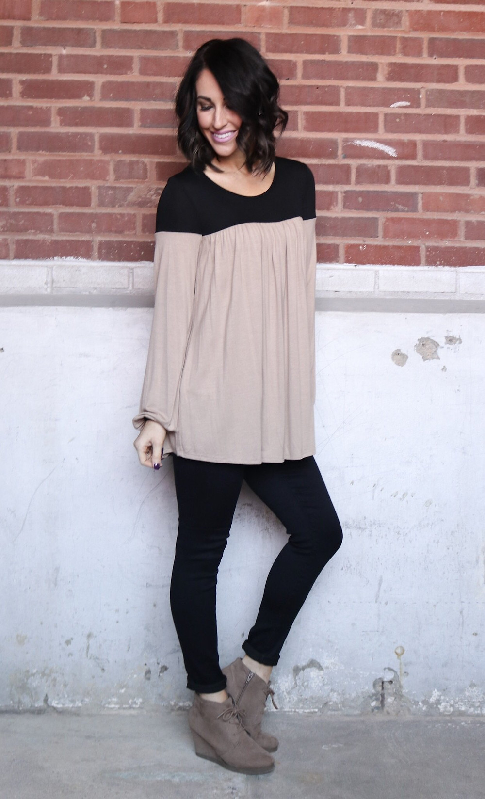 perfect top for a night out. Black and Taupe long sleeve with high waited black jeans