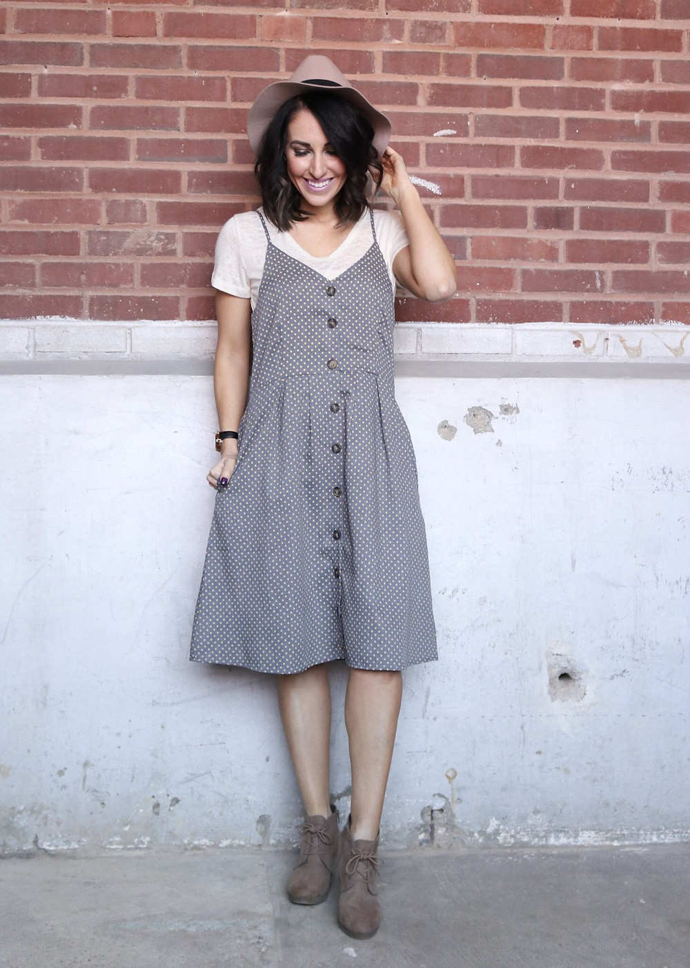 grey polka dotted dress with blush hat