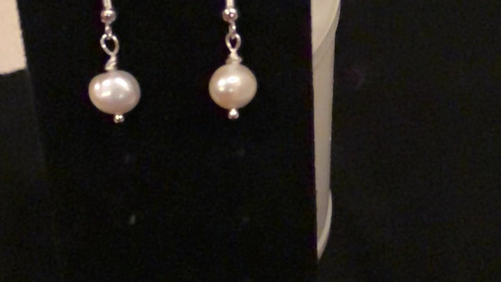 A basic drop pearl earring that is made with freshwater pearls.