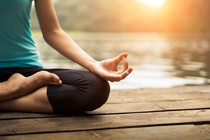 Close up hands. Woman do yoga outdoor. Woman exercising vital and meditation for fitness lifestyle c