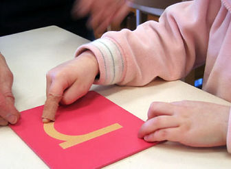 Child hands with letter