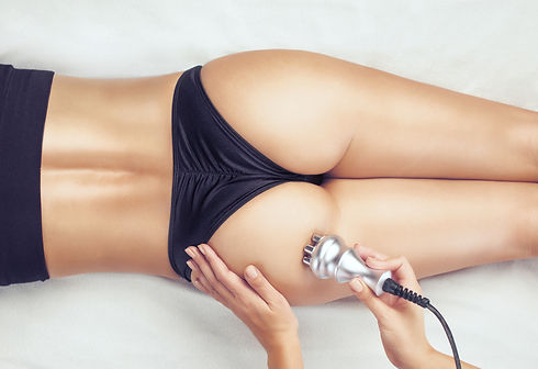 The doctor does the Rf lifting procedure on the legs, buttocks and hips of a woman in a be