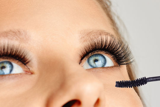 Female eyes with long eyelashes and brus