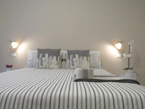 8 Colonne Apartments camera da letto