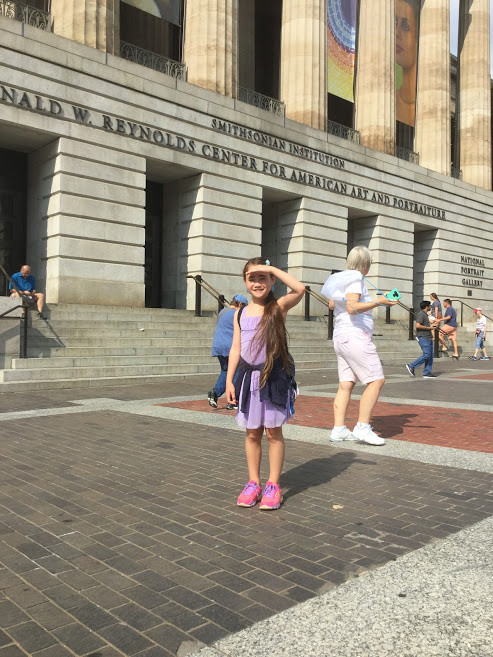 In front of Smithsonian American Art and Portraiture Museum in D.C.