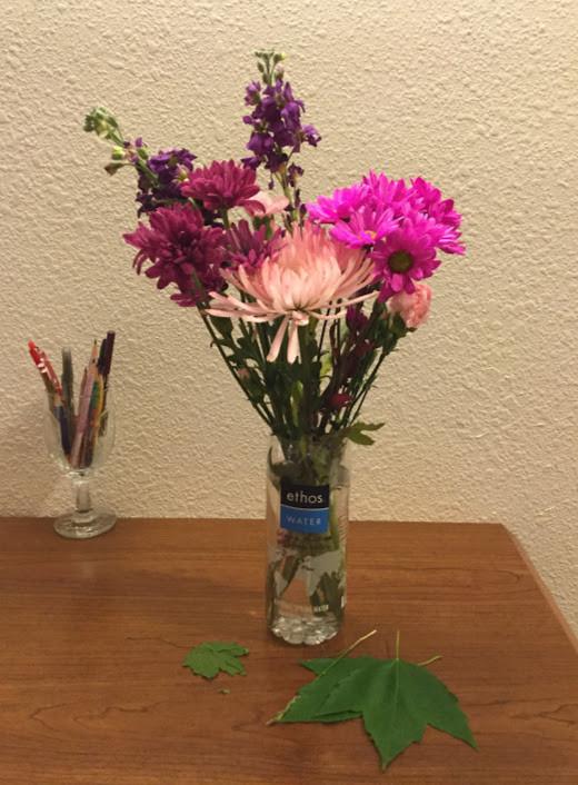 A water-bottle flower arrangement