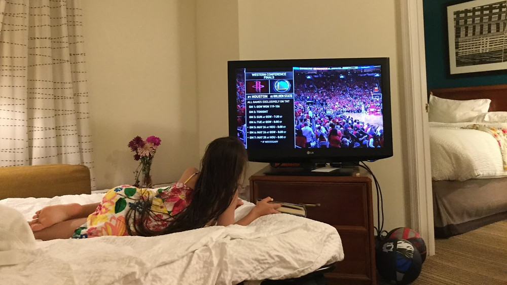 Watching the NBA playoff on the bed