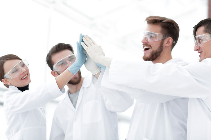 scientists giving each other a high five