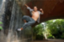 Photo of Cristian Valle Freelance Choreographer Director In London UK this Image represent Cristian Valle Dancing on the wall of a tunnel in the streets of London
