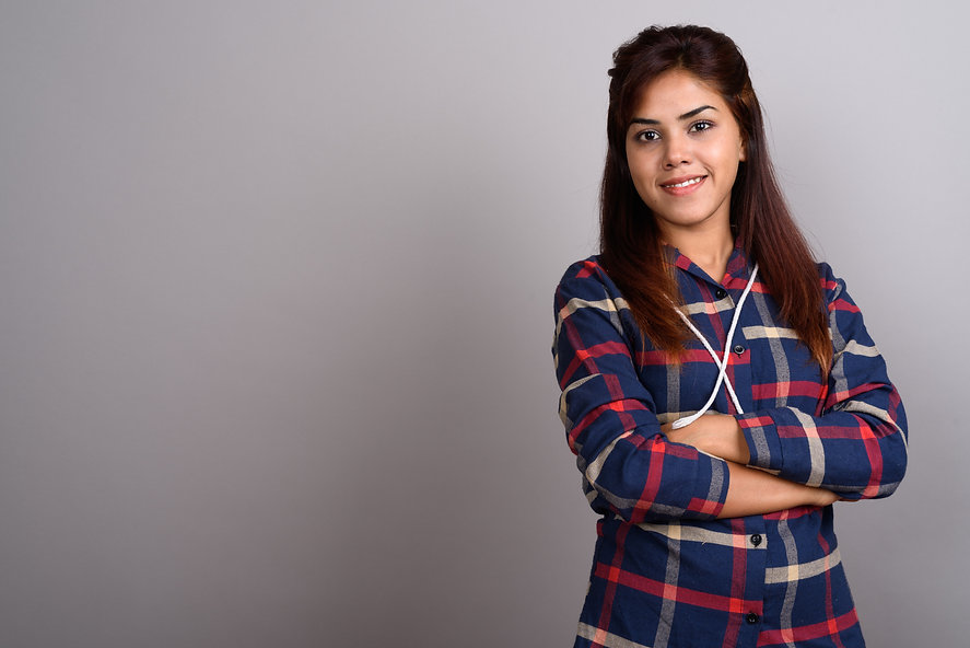 young-beautiful-indian-woman-wearing-checked-shirt-against-gray.jpg