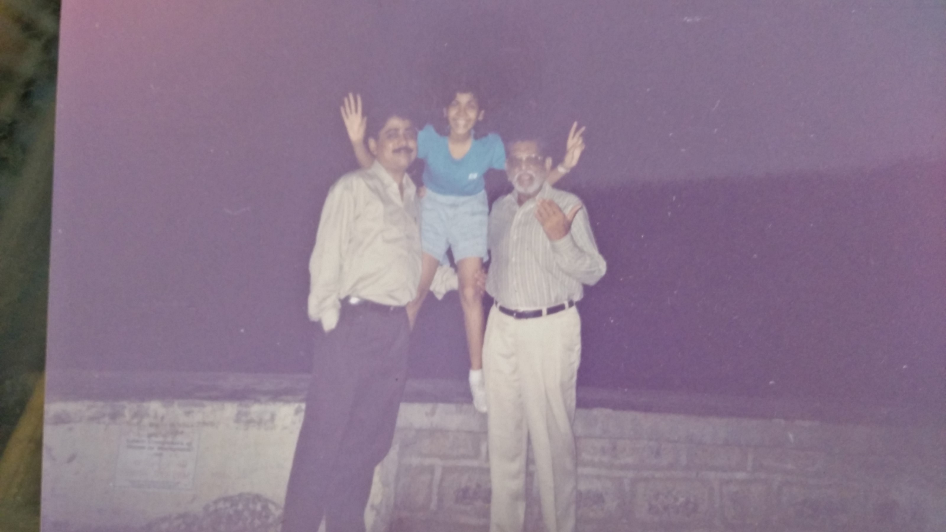 With her 2 favourite men- Dad & Dada