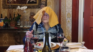 Ethel presents the opening Passover prayer using an extra-large napkin ...