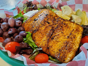 Blackened Mahi on a Greek salad
